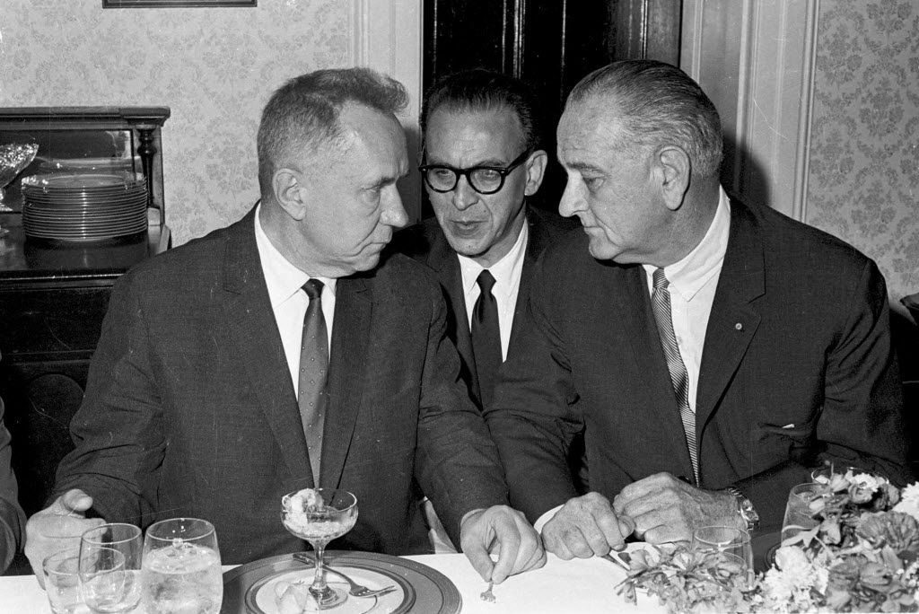 FILE - This June 23, 1967 black-and-white file photo shows Soviet Premier Alexei N. Kosygin, left, meeting with President Lyndon Johnson for a luncheon meeting of the Big Two leaders in Glassboro, N.J.  At center is U.S. State Department Interpreter Bill Krimer relaying Johnson's words to the Soviet Premier.