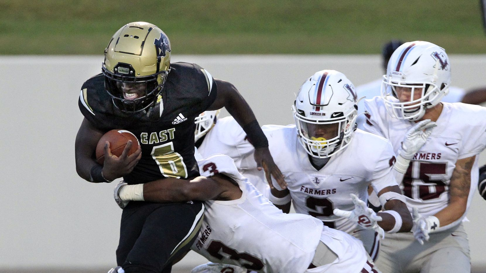 Plano East's Ismail Mahdi (6) picks up a couple of yards, but is hit by many Lewisville defenders, including Myles Johnson (3) during the first half of a high school football game at Kimbrough Stadium in Murphy on Friday, October 1, 2021.