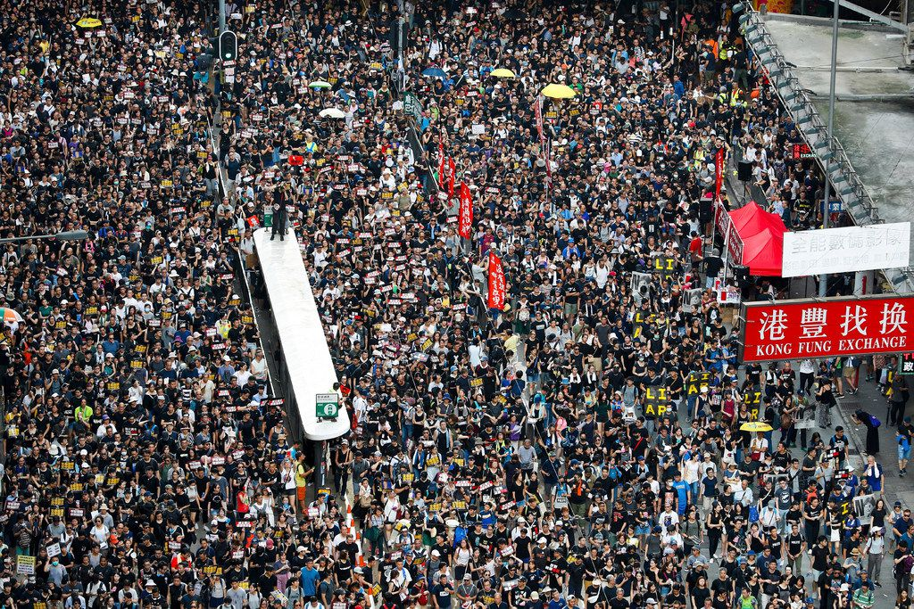 Protesters take part in a march on a street in Hong Kong. Hong Kong's protest movement has reached a moment of reckoning after protesters occupying the airport held two mainland Chinese men captive, and pro-democracy lawmakers and fellow demonstrators question whether the whole operation has gone too far.
