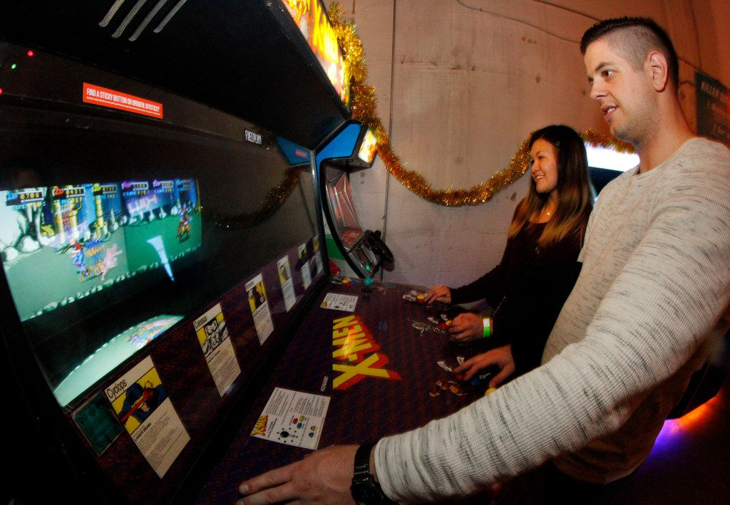 Michael Smith and Tiffany Chen compete against each other during a game of X-men while on a date at the Bishop Cidercade.