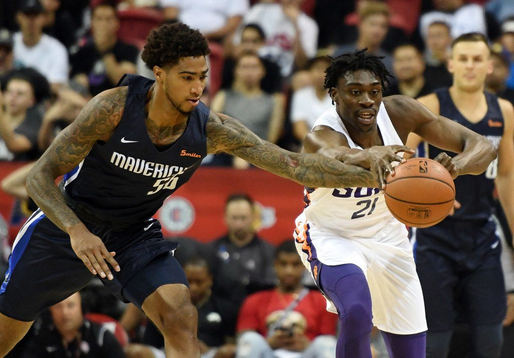 LAS VEGAS, NV - JULY 06:  Ray Spalding #56 of the Dallas Mavericks tries to steal the ball from Tai Odiase #21 of the Phoenix Suns during the 2018 NBA Summer League at the Thomas & Mack Center on July 6, 2018 in Las Vegas, Nevada. The Suns defeated the Mavericks 92-85.  (Photo by Ethan Miller/Getty Images)