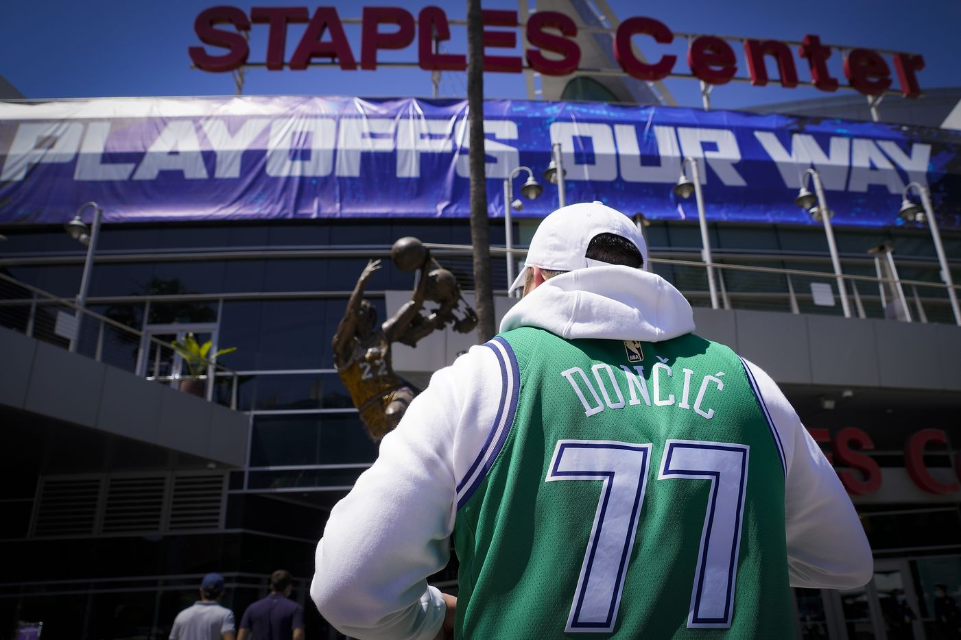 Dallas Mavericks fans head to the arena before Game 7 of an NBA playoff basketball series against the LA Clippers at the Staples Center on Sunday, June 6, 2021, in Los Angeles.