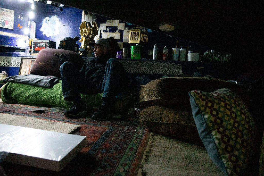 Spencer Cardwell takes a moment on his couch at his encampment during the annual homeless count in Dallas on Thursday, Jan. 24, 2019.