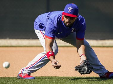 Texas Rangers infielder Isiah Kiner-Falefa takes grounders at shortstop during an informal workout following the first spring training workout for pitchers and catchers at the team's training facility on Wednesday, Feb. 12, 2020, in Surprise, Ariz.