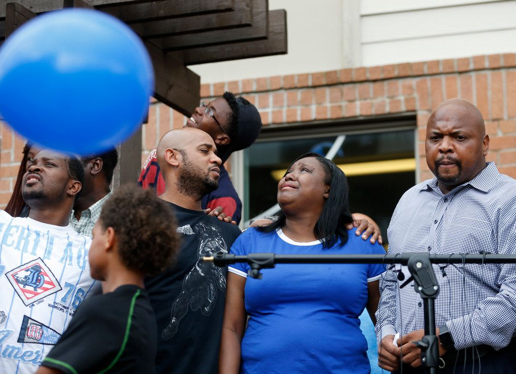 Tina Tyler (center) watches as balloons are released in the sky during a vigil for her son Malik Tyler at the Sterlingshire Apartments near the scene of the shooting in Dallas on Wednesday, June 5, 2019. Tyler was injured and killed in crossfire in the 9400 block of Bruton Road Tuesday night. Next to Tina is her boyfriend Christopher White (left) and Terrence Perkins (right). (Vernon Bryant/The Dallas Morning News)