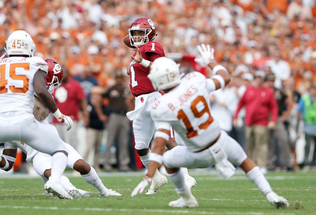 Oklahoma Sooners quarterback Kyler Murray (1) prepares to throw the ball in a game against the Texas Longhorns during the first half of play in a NCAA football game  between Texas Longhorns and the Oklahoma Sooners at the Cotton Bowl in Dallas on Sunday, October 6, 2018. (Vernon Bryant/The Dallas Morning News)
