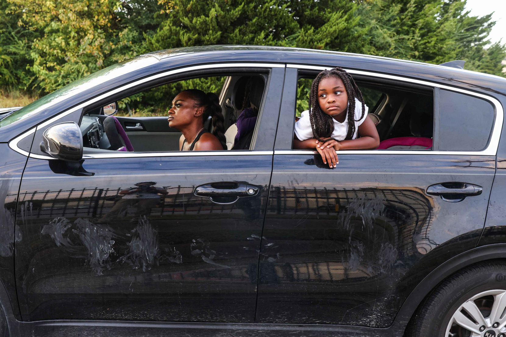 Highland Hills Apartments resident Dejanette Dennis and one of her daughters, 7-year-old Azariah, wait to be allowed entry into Dennis' unit to collect belongings on Friday, Oct. 1, 2021.