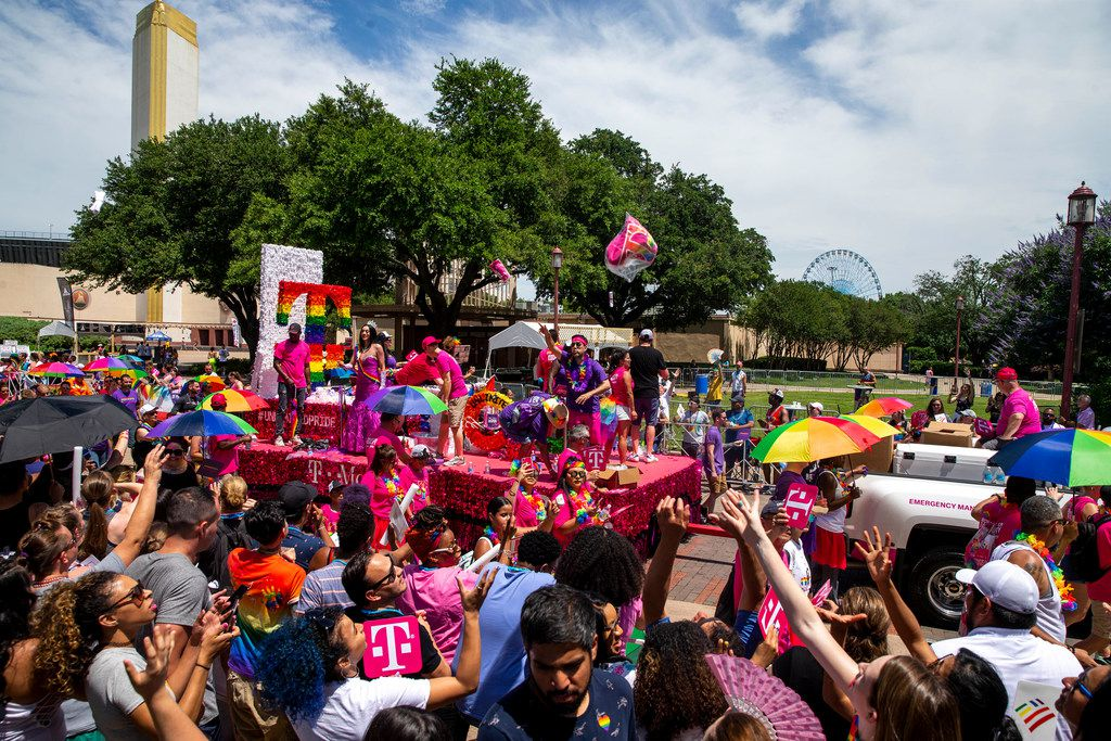 Parade-goers attempt to catch souvenirs during the annual Dallas Pride/Alan Ross Texas Freedom Parade at Fair Park in Dallas on Sunday, June 2, 2019.