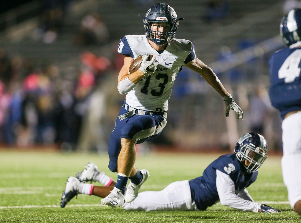 Flower Mound running back Pierce Hudgens (13) breaks away from defensive back Nyron Collins (3) for a run during a matchup between Nimitz and Flower Mound on Thursday, Oct. 11, 2018 in Irving, Texas. (Ryan Michalesko/The Dallas Morning News)