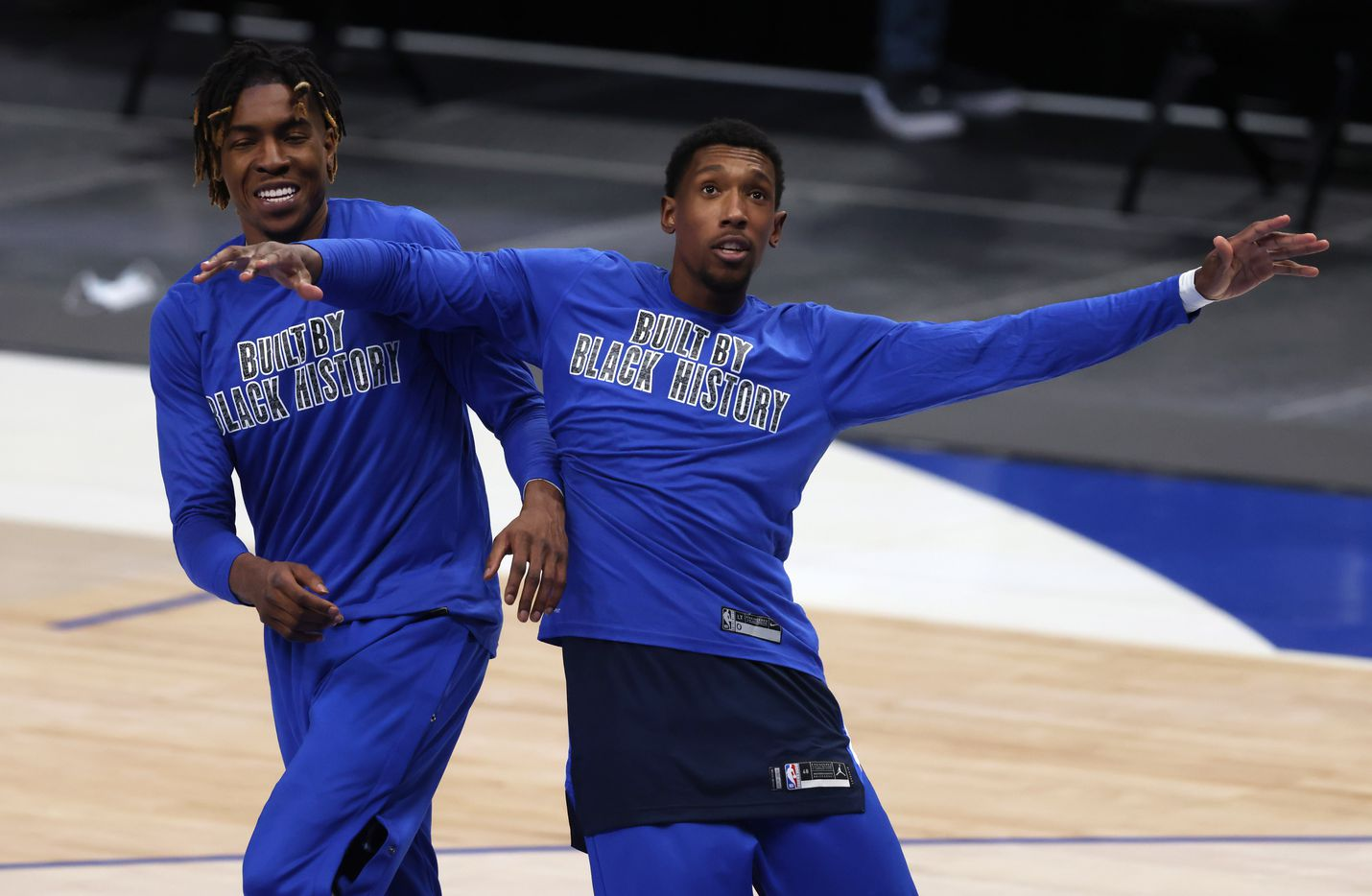 Dallas Mavericks forward Wes Iwundu (25) and Dallas Mavericks guard Josh Richardson (0) wear shirts supporting Black history month during pregame warmups before a game against the Phoenix Suns at American Airlines Center on Monday, February 1, 2021in Dallas. (Vernon Bryant/The Dallas Morning News)