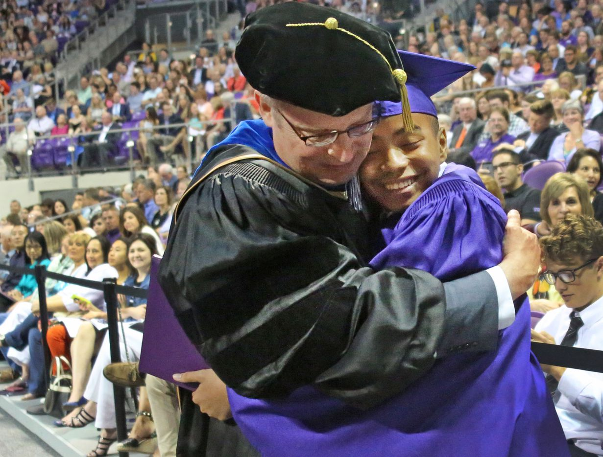 14-year-old Carson Huey-You gets a hug from his mentor, physics professor Magnus Rittby, after receiving a bachelor's degree in physics at the TCU commencement held in Fort Worth on Saturday, May 13, 2017. Huey-You, the youngest student ever to attend Texas Christian University, also double minored in math and Chinese since enrolling in 2013.