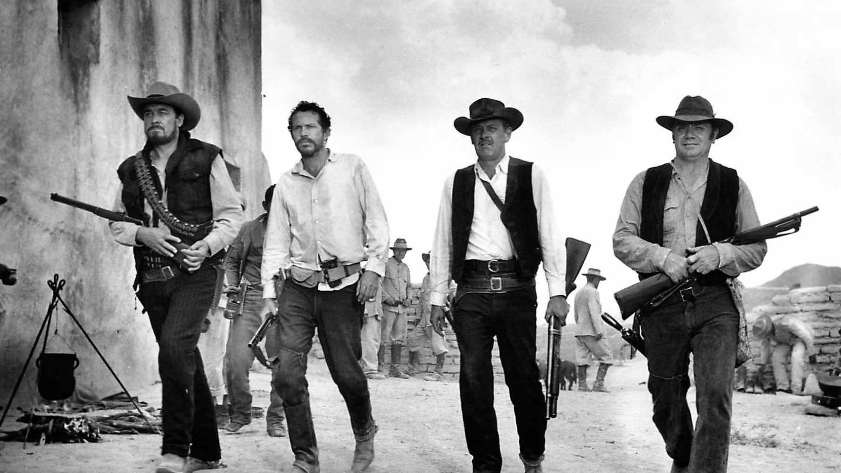 From left are actors Ben Johnson as Tector Gorch, Warren Oates as Lyle Gorch, William Holden as Pike Bishop and Ernest Borgnine as Dutch Engstrom in Warner Bros.' 1995 restored release of Sam Peckinpah's 1969 Western The Wild Bunch.
