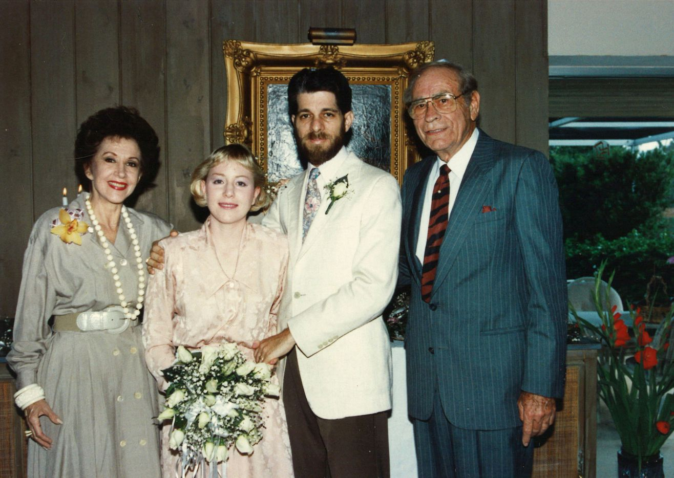 """Jeffrey Weiss and his wife Marni, on the occasion of what they called their """"first wedding"""" in May 1990. (They held a second ceremony later that year.) With them are Jeffrey's parents, Lenore and Sherburt Weiss."""