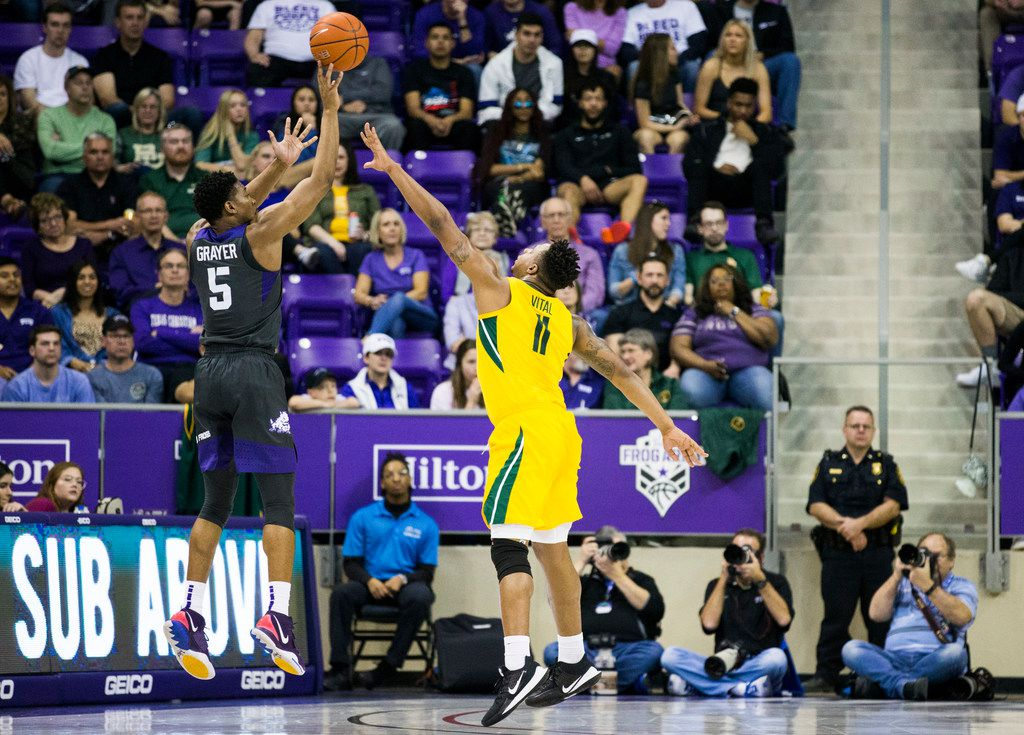 TCU Horned Frogs guard Jaire Grayer (5) takes a shot over Baylor Bears guard Mark Vital (11) during the first half of an NCAA mens basketball game between Baylor and TCU on Saturday, February 29, 2020 at Ed & Rae Schollmaier Arena on the TCU campus in Fort Worth. (Ashley Landis/The Dallas Morning News)