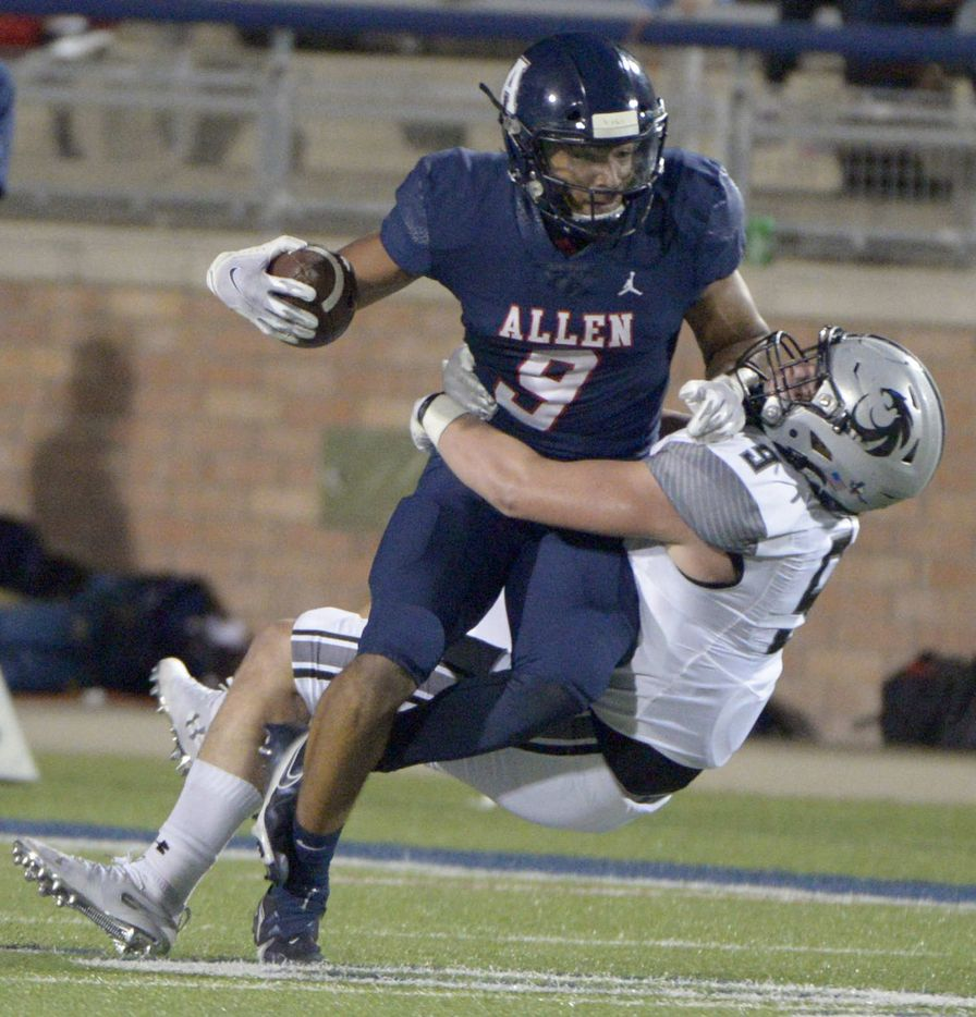 Allen's Bryson Green (9) tries to run through a tackle attempt by Denton Guyer's Rowan Briggs in the second quarter of a high school football game between Denton Guyer and Allen, Friday, Nov. 13, 2020, in Allen, Texas. (Matt Strasen/Special Contributor)