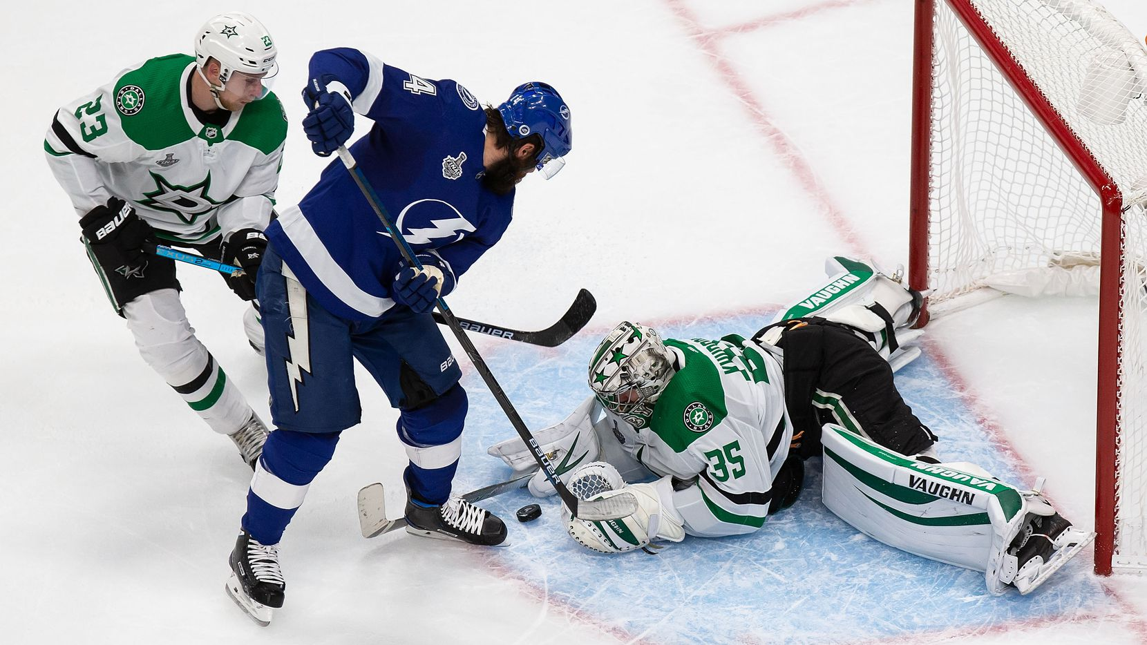 Esa Lindell (23) and goaltender Anton Khudobin (35) of the Dallas Stars defend against Pat Maroon (14) of the Tampa Bay Lightning during Game Two of the Stanley Cup Final at Rogers Place in Edmonton, Alberta, Canada on Monday, September 21, 2020.