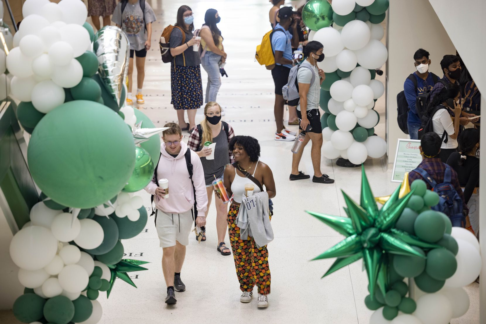 Students walk through the university union during the first day of class on Monday, Aug. 23, 2021, at the University of North Texas in Denton. (Juan Figueroa/The Dallas Morning News)