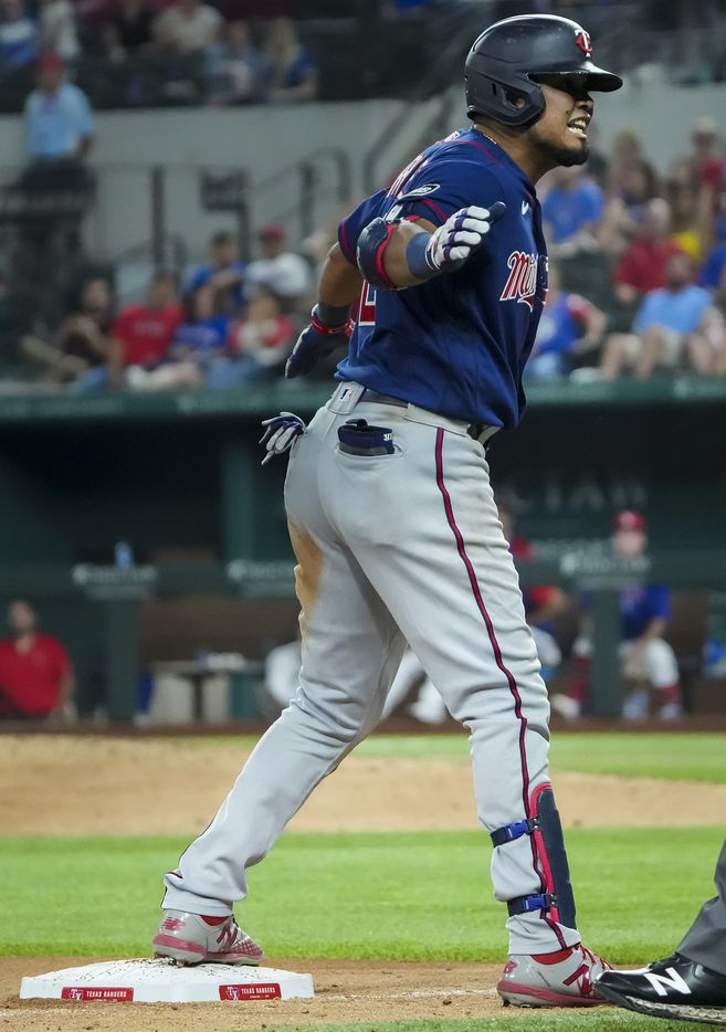 Minnesota Twins second baseman Luis Arraez celebrates after driving in a run with a triple during the tenth inning against the Texas Rangers at Globe Life Field on Friday, June 18, 2021.
