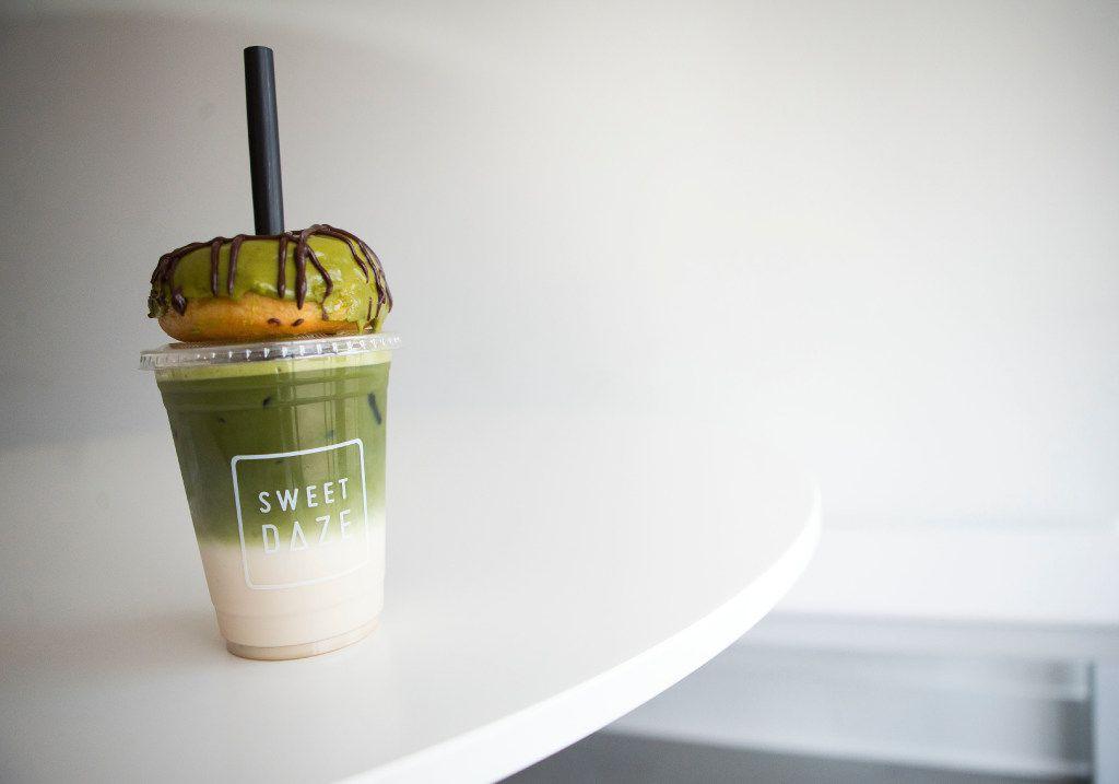 A matcha donut tops an iced matcha latte at Sweet Daze Dessert Bar on Thursday, June 15, 2017, in Richardson, Texas. (Ryan Michalesko/The Dallas Morning News)