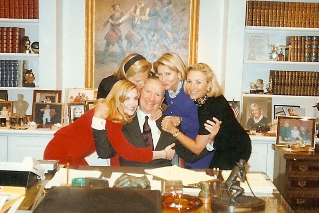 Daughters Katherine Reeves, Suzanne McGee, Nancy Perot and Carolyn Rathjen hug Ross Perot in his office in 1996.