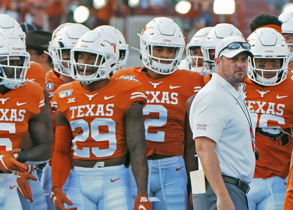 Texas head coach Tom Herman waits with his team before the start of an NCAA college football game against Oklahoma State, Saturday, Sept. 21, 2019, in Austin, Texas.