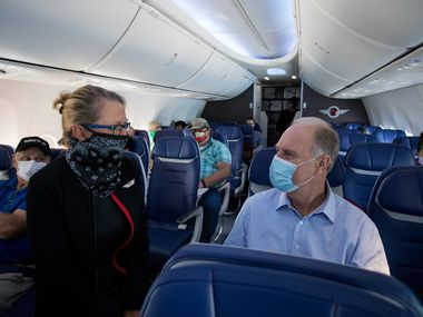 Gary Kelly chats with a flight attendant during a trip to Denver International Airport in June.