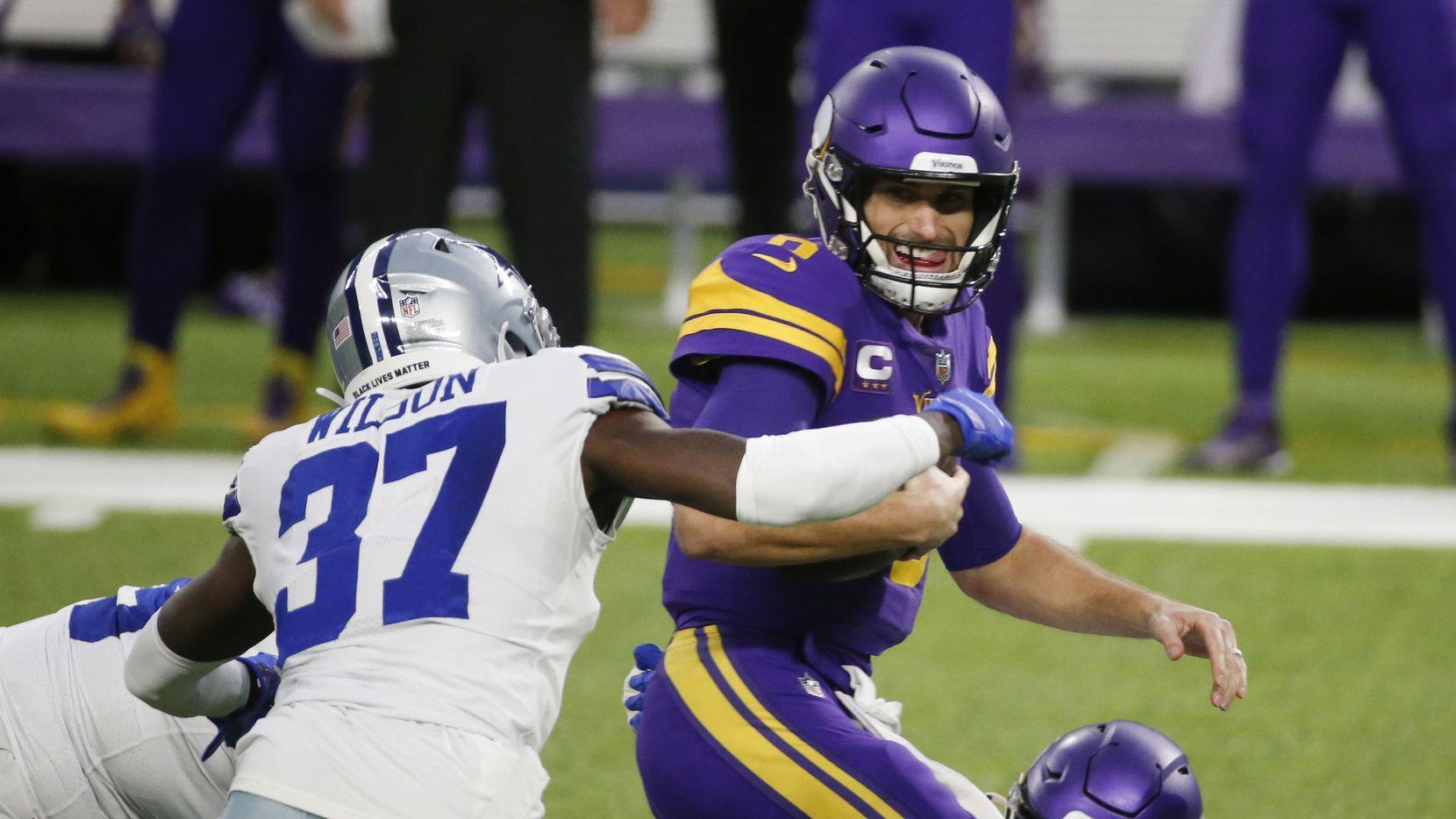 Dallas Cowboys safety Donovan Wilson (37) sacks Minnesota Vikings quarterback Kirk Cousins, right, during the first half of an NFL football game, Sunday, Nov. 22, 2020, in Minneapolis. (AP Photo/Bruce Kluckhohn)