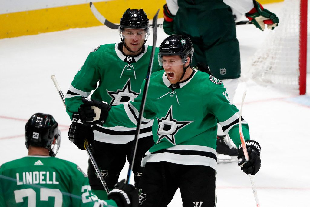 Dallas Stars defenseman Esa Lindell (23), Joe Pavelski (16) and Miro Heiskanen (4) celebrate a goal scored by Pavelski in the third period of an NHL hockey game against the Minnesota Wild in Dallas, Tuesday, Oct. 29, 2019. (AP Photo/Tony Gutierrez)