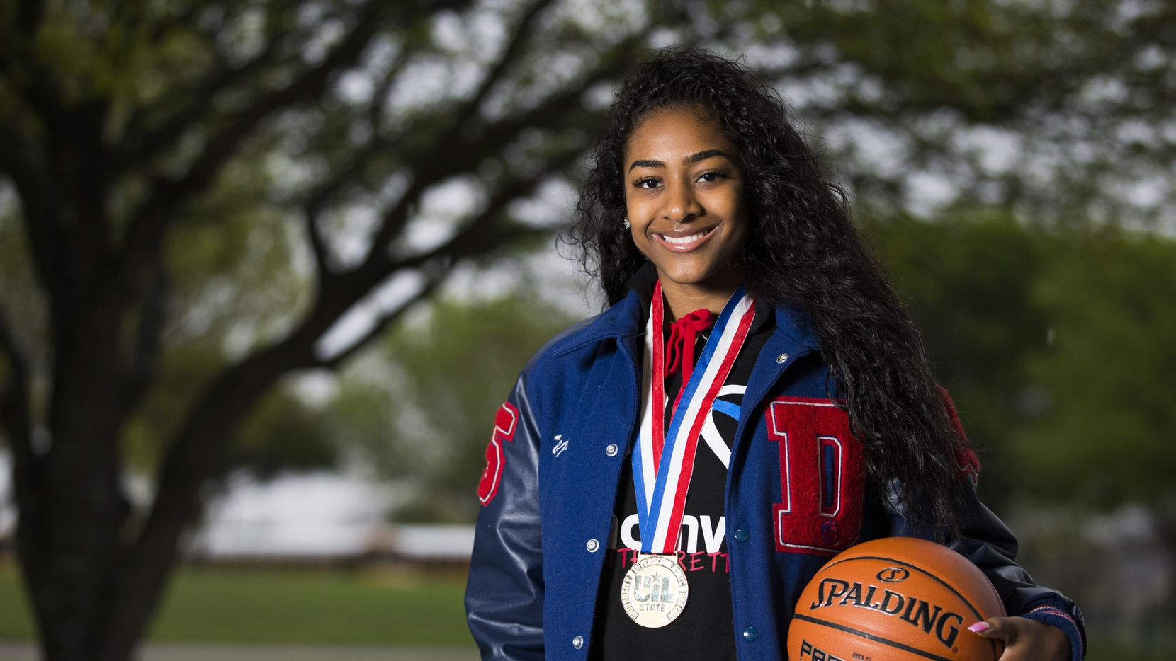 Duncanville senior guard Deja Kelly was named SportsDay's All-Area Girls Basketball Player of the Year after leading her school to the Class 6A state championship.