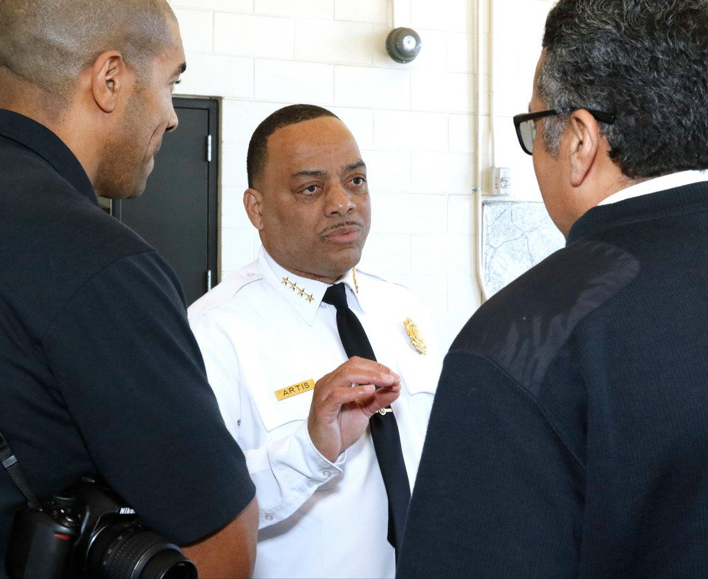 Dominique Artis talks with Dallas Fire-Rescue spokesman Jason Evans (left) and Asst. Chief Daniel Salazar after speaking to the news media Friday.