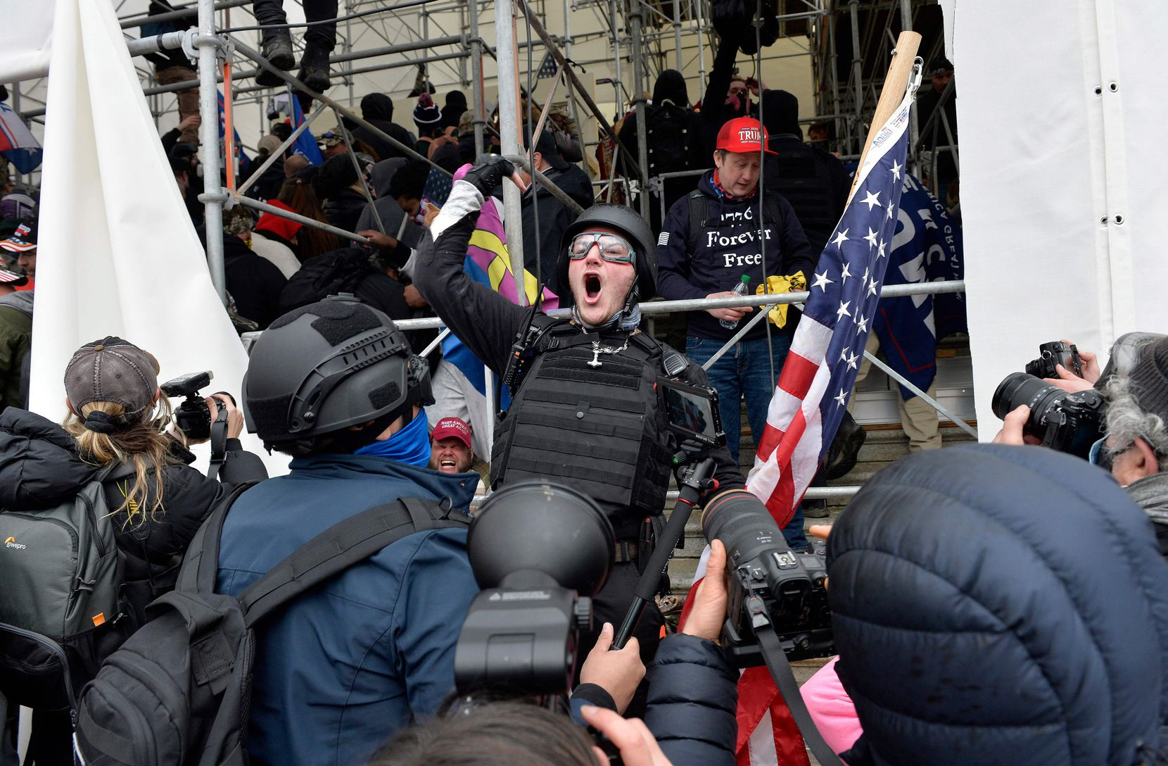 A man calls on people to raid the building as Trump supporters clash with police and security forces as they try to storm the Capital Building in Washington D.C on January 6, 2021. - Demonstrators breeched security and entered the Capitol as Congress debated the a 2020 presidential election Electoral Vote Certification. (Photo by Joseph Prezioso / AFP) (Photo by JOSEPH PREZIOSO/AFP via Getty Images)