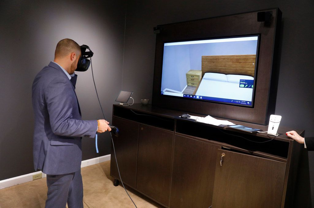 NorthPark Macy's vice president/store manager Josh Adkins demonstrates how the furniture virtual reality system works to design your living spaces.