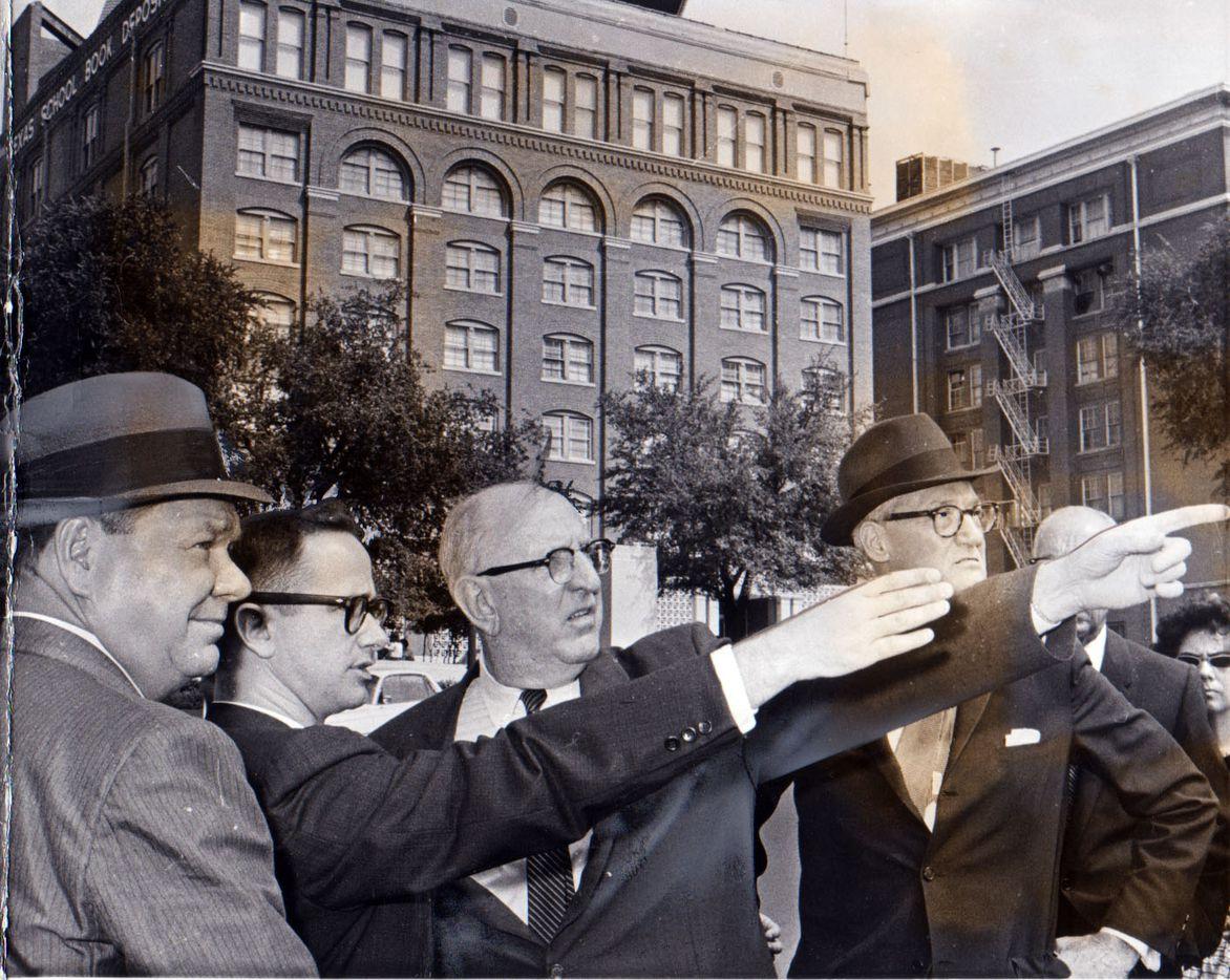 From left: Warren Commission members Rep. Hale Boggs, Secret Service agent John Joe Howlett, Sen. Richard Russell and Sen. John S. Cooper visited Dealey Plaza in late November 1963.