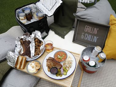 The Father's Day cooler special offered from Jaxon Texas Kitchen and Beer Garden in downtown Dallas includes a five pack of mixed beer, 1 lb. of brisket, 1 lb. of pork, bread, pickles, onions, jalapeños, BBQ sauce, potato salad, slaw, beans and banana pudding along with a free cooler.