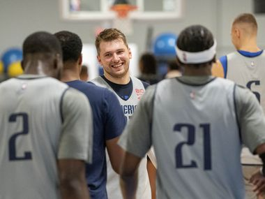 Dallas Mavericks guard Luka Dončić laughs with teammates during the first practice of training camp Tuesday, September 28, 2021 at the Dallas Mavericks Training Center in Dallas.