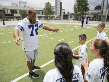 Dallas Cowboys center Travis Frederick (72) explains the next exercise to fourth graders from Christie elementary school during a Frisco ISD's Fuel Up to Play 60 program in front of the Ford Center at The Star in Frisco on Tuesday, May 16, 2017. Frederick's, Blocking Out Hunger Foundation will provide a box of food a week to 200 kids for 10 weeks of the summer break. This is for kids who rely on free or reduced lunches during the school year.