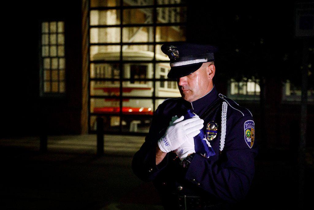 DART police Officer Chris Cobb carries the U.S. Honor Flag.