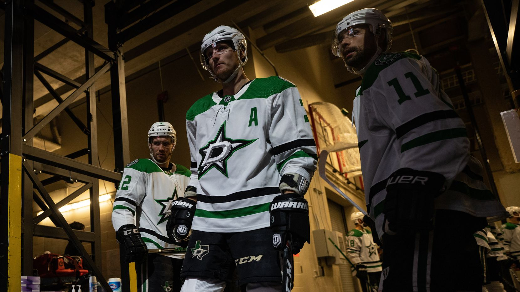 From L to R: Dallas Stars forward Radek Faksa (12), defenseman John Klingberg (3), forward Andrew Cogliano (11).