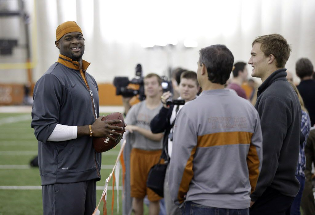 Former University of Texas and NFL quarterback Vince Young, left, talks with Texas quarterback David Ash, right, during Texas' Pro Day, Tuesday, March 26, 2013, in Austin, Texas.