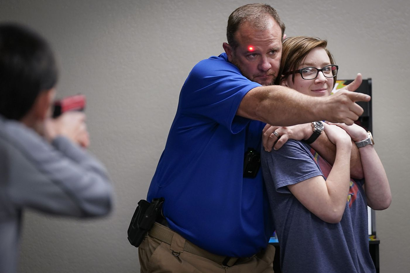 Instructor David Riggall portrays a hostage taker as Shelby Fox portrays the hostage during a Sheepdog Defense Group armed security programs church safety training at Cornerstone Community Church on Sunday, Feb. 2, 2020 in Springtown, Texas.