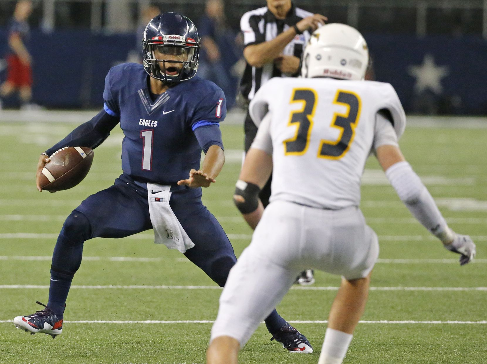 FILE - Allen quarterback Kyler Murray (1) scrambles away from Cypress Ranch's Brayden Stringer during the Class 6A, Div. I state championship game at AT&T Stadium in Arlington on Saturday, Dec. 20, 2014.