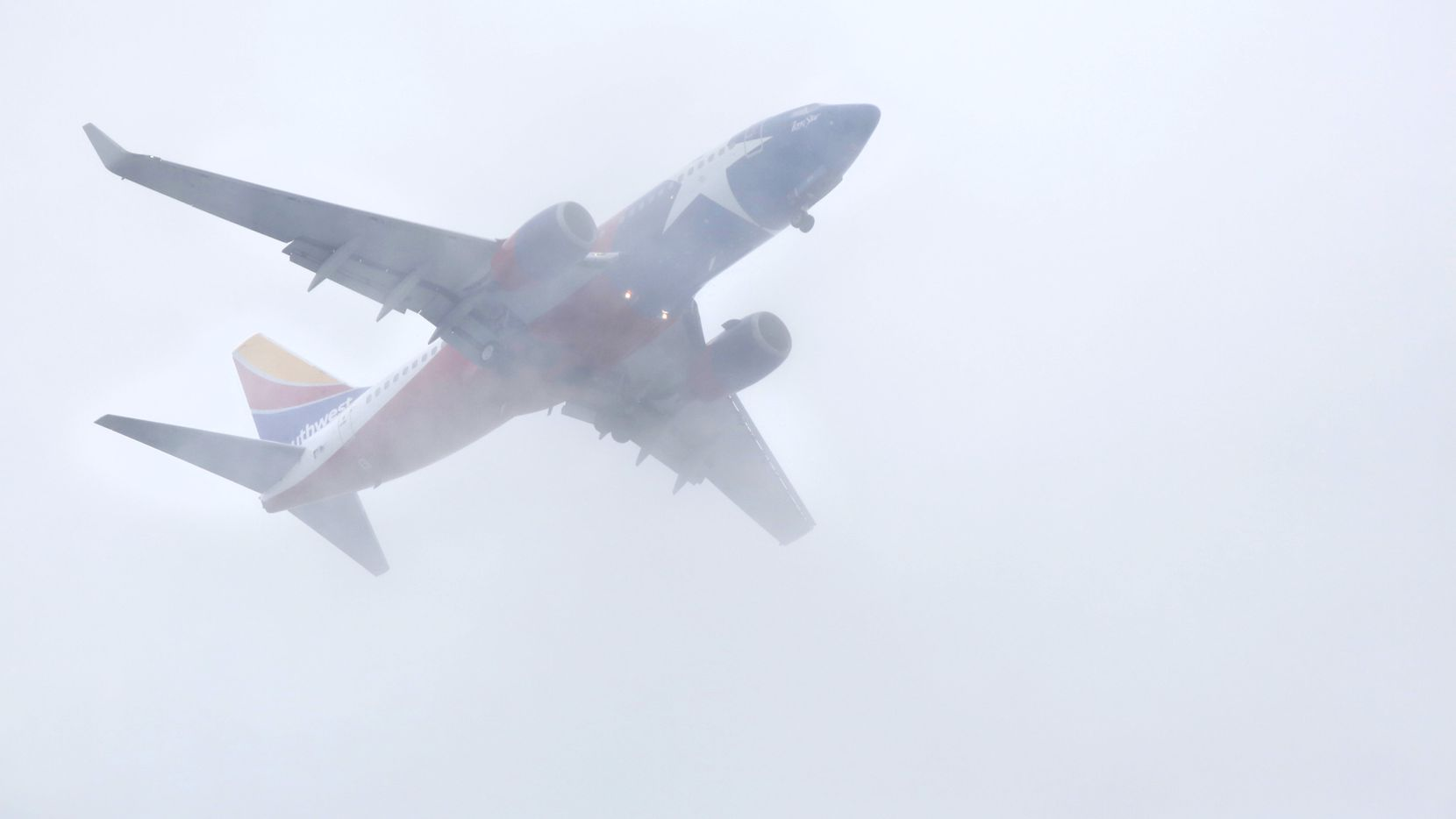 A Southwest Airlines jet cut through a low cloud bank over downtown as it made its approach to Dallas Love Field in October 2018.