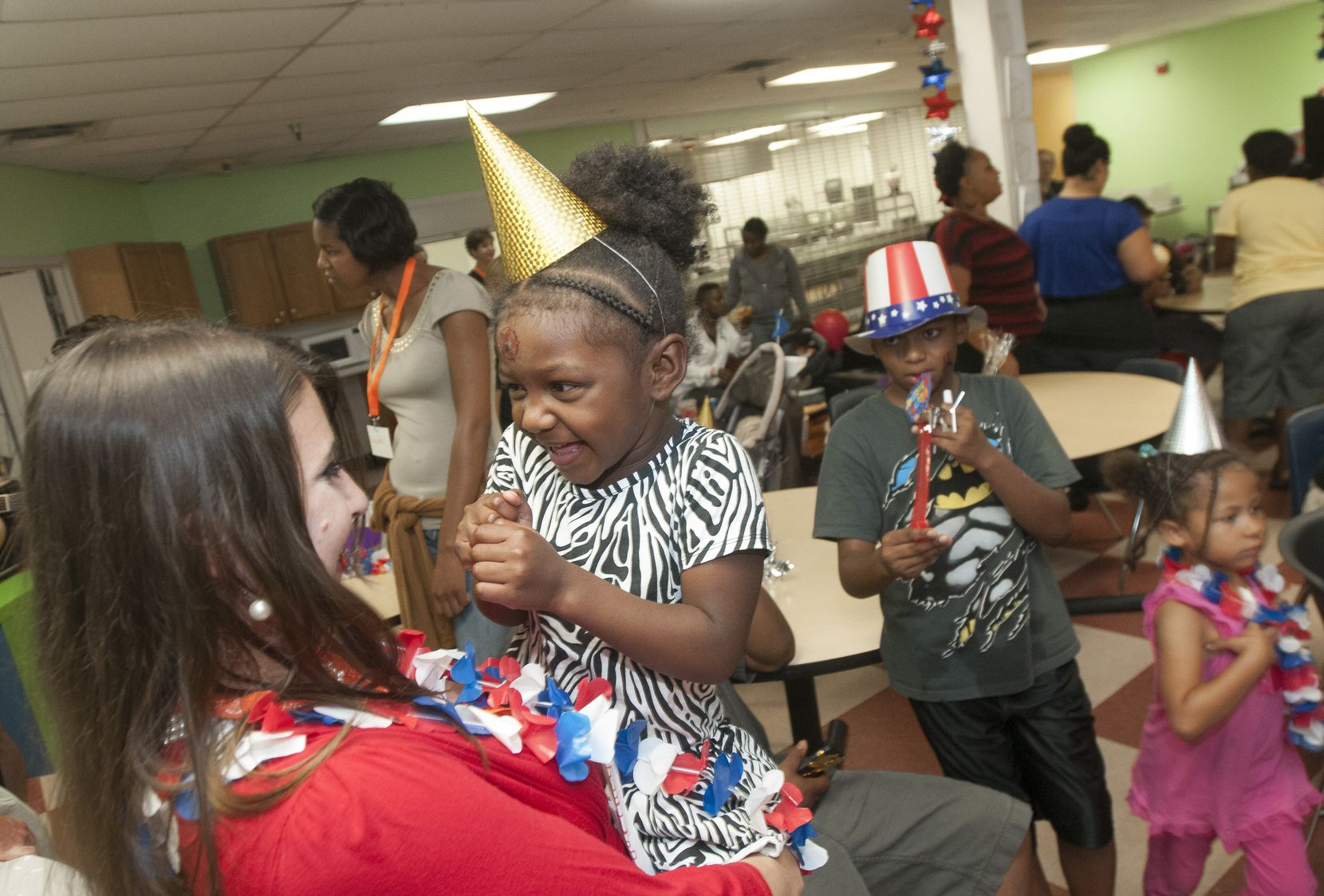 """Courtney Underwood helped organize a birthday party for children at Family Gateway in July 2014 as part of her participation in the Dallas Foundation's """"Good Works Under 40"""" awards."""