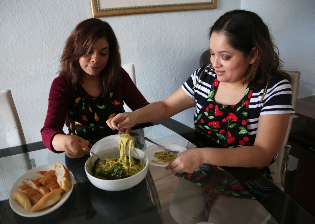 Carolina Maldonado (right), pitmaster at Lockhart Smokehouse, eats Poblano Pepper Spaghetti with her aunt Rosa Maldonado at her aunt's home in Dallas.
