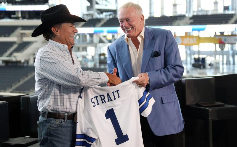 Jerry Jones presents country superstar George Strait with a Cowboys jersey during a press conference detailing the singer's 2014 touring plans, held at AT&T Stadium in Arlington, in September, 2013