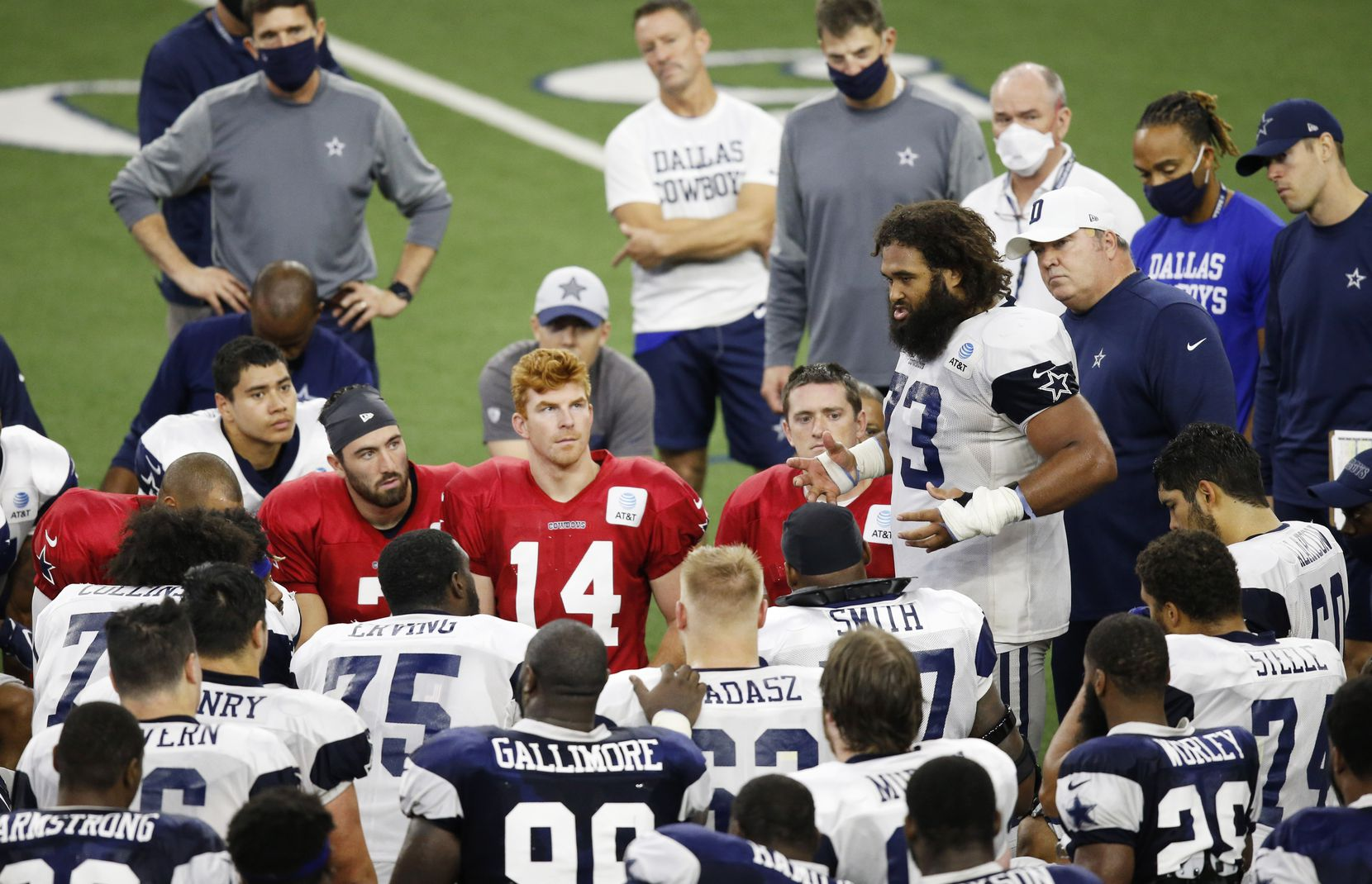 Dallas Cowboys center Joe Looney (73) talks to his teammate shortly after practice during training camp at the Dallas Cowboys headquarters at The Star in Frisco, Texas on Thursday, August 27, 2020. (Vernon Bryant/The Dallas Morning News)