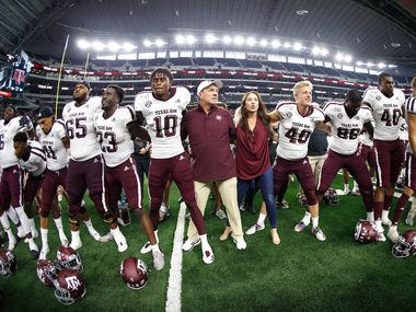 FILE - Texas A&M head coach Jimbo Fisher celebrates with his team after defeating Arkansas on Sept. 28, 2019, in Arlington. Texas A&M won 31-27. (AP Photo/Ron Jenkins)