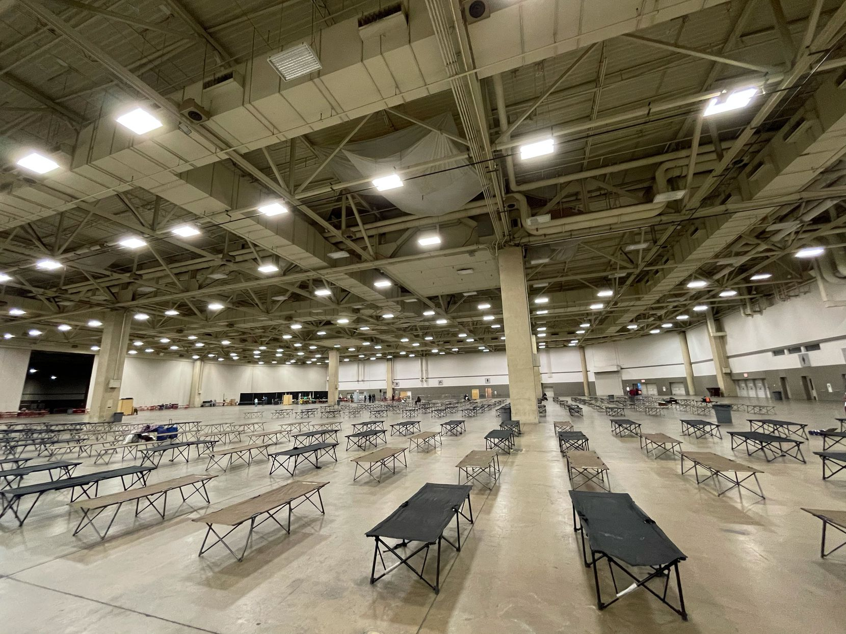 The Kay Bailey Hutchison convention center in Dallas opened Feb. 12 to shelter the homeless during the subfreezing temperatures predicted for the coming days. The City's Office of Emergency Solutions is providing the cots and Shoreline City Church has donated pallets of masks. Breakfast, lunch and dinner - prepared at the kitchens of OurCalling, Salvation Army and The Stewpot - will be served daily. (Ali Hendricksen)