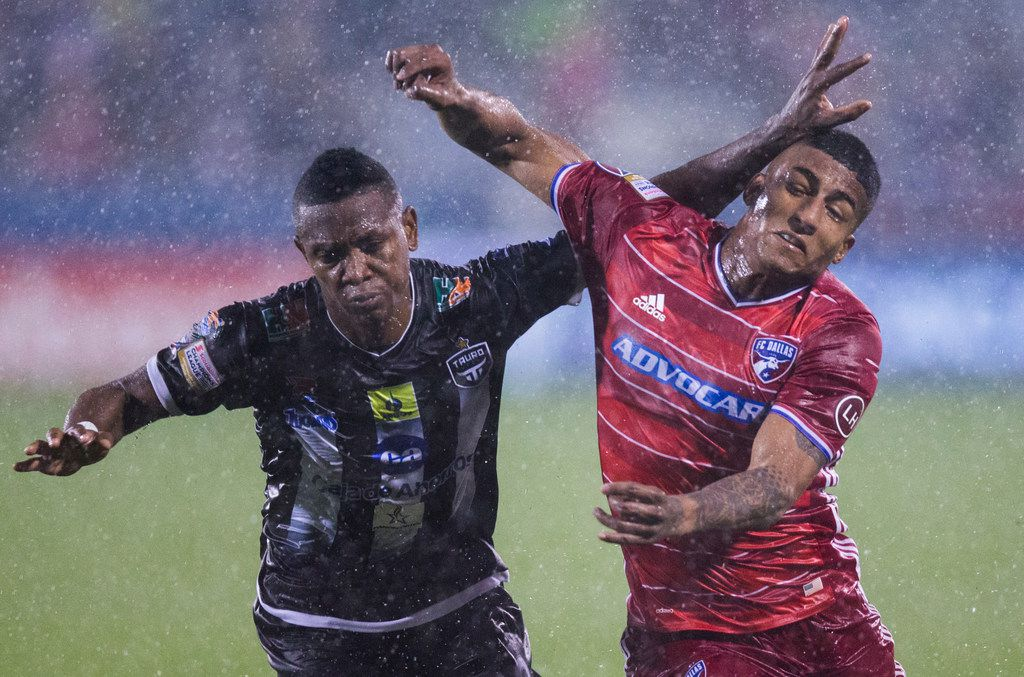 FC Dallas midfielder Santiago Mosquera (11) gets a hand to the face from Tauro F.C.'s Rigoberto Nino (2) during the second half of a CCL Leg 2 game between FC Dallas and Tauro FC on Wednesday, February 28, 2018 at Toyota Stadium in Frisco, Texas. (Ashley Landis/The Dallas Morning News)