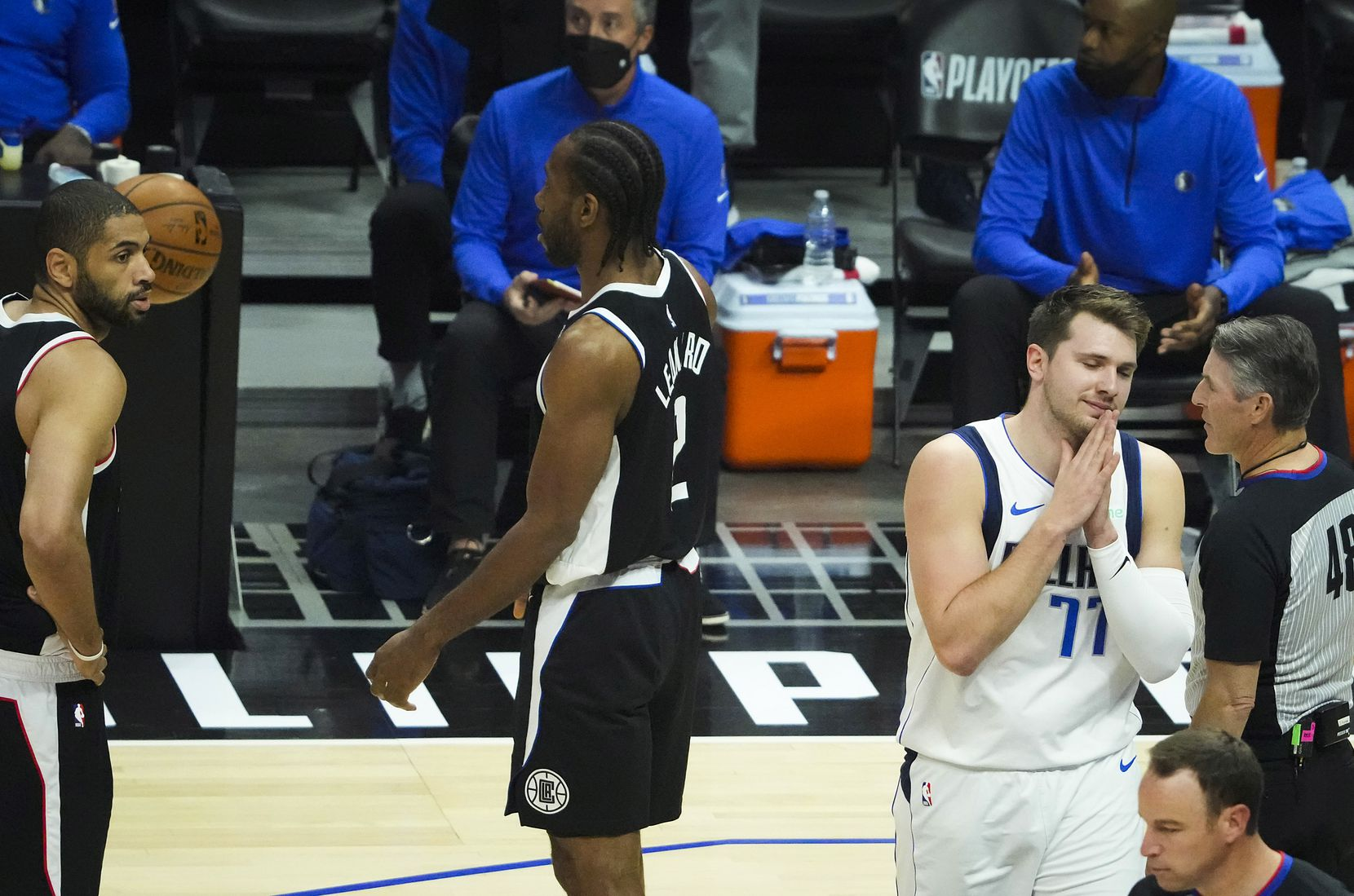 Dallas Mavericks guard Luka Doncic (77) reacts after having a call go against him during the first quarter of Game 7 of an NBA playoff series against the LA Clippers at the Staples Center on Sunday, June 6, 2021, in Los Angeles.